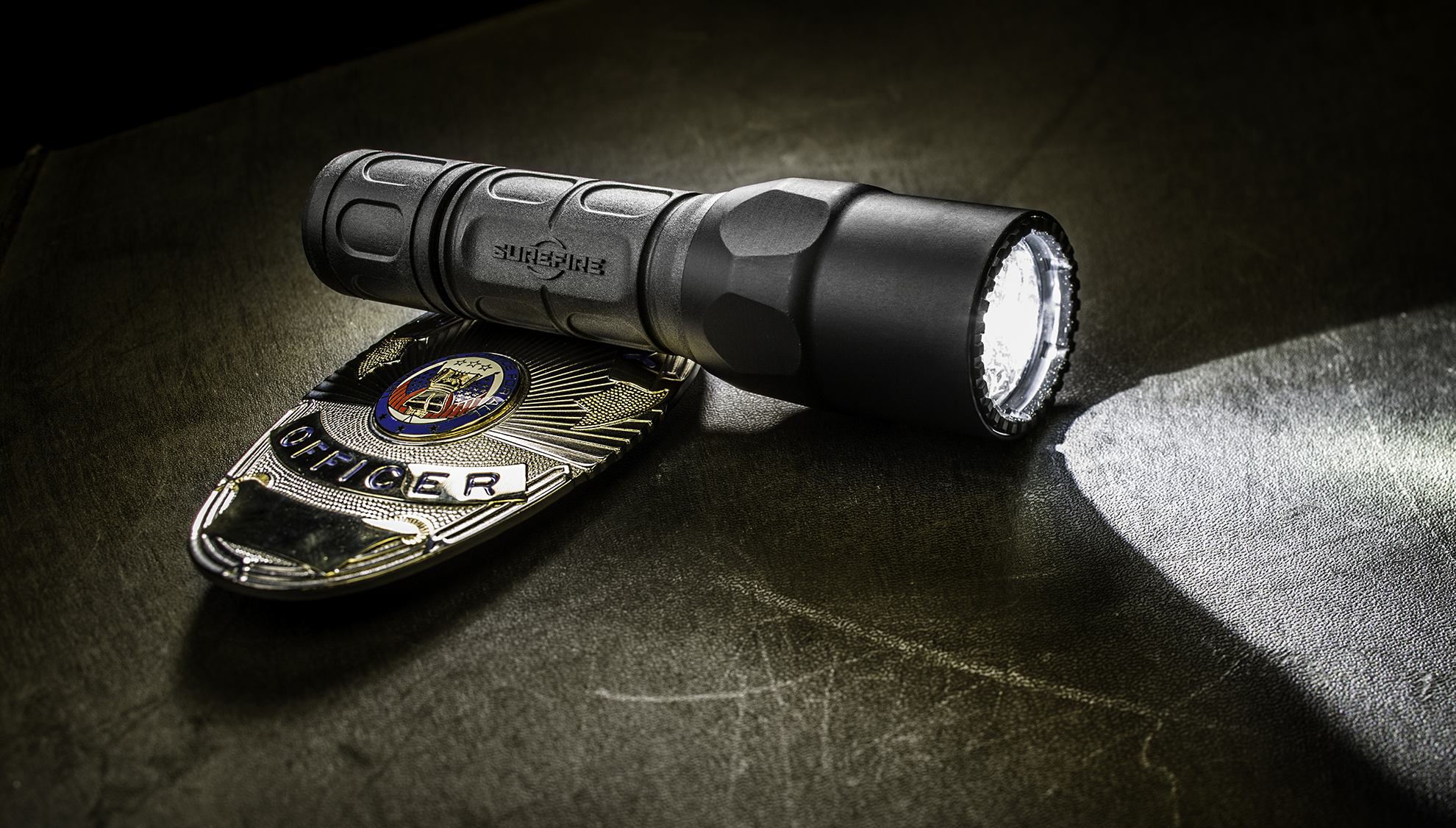 SureFire G@X LE flashlight with police badge