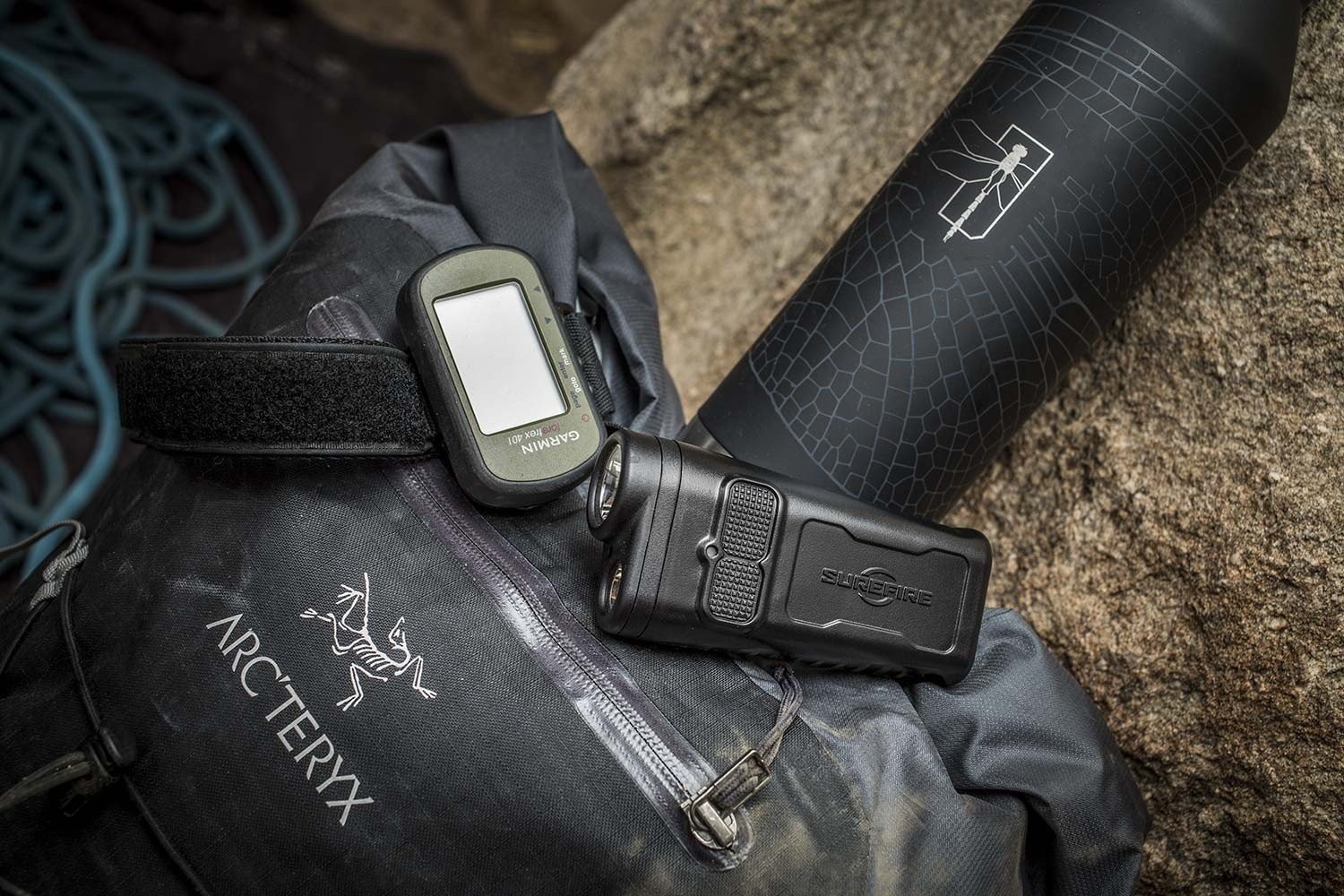 SureFire Guardian flashlight with camping backpack