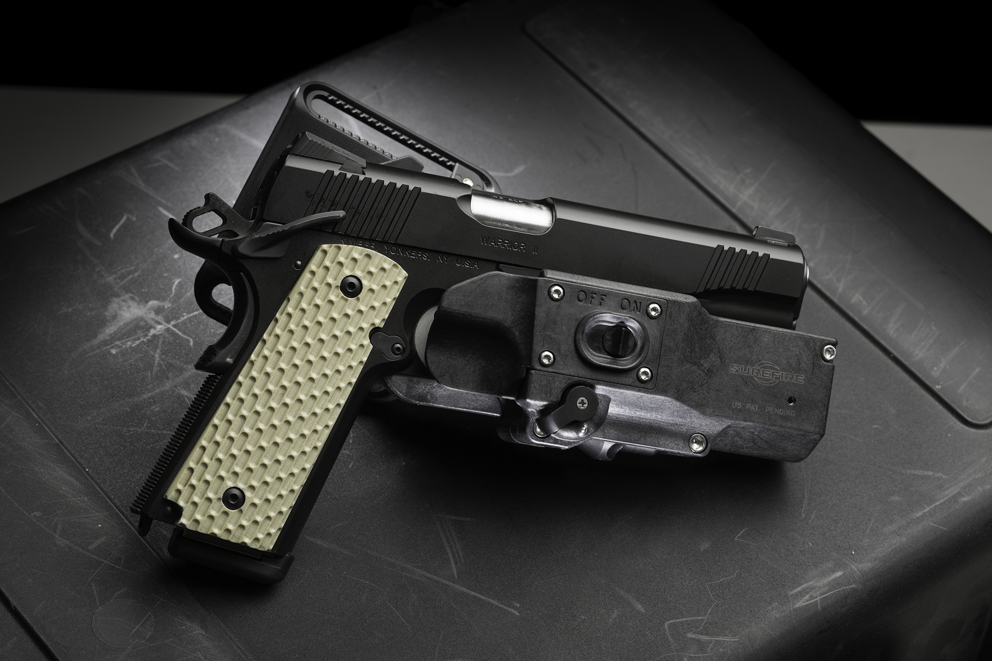 SureFire MasterFire Holster with Kimber 1911-style pistol