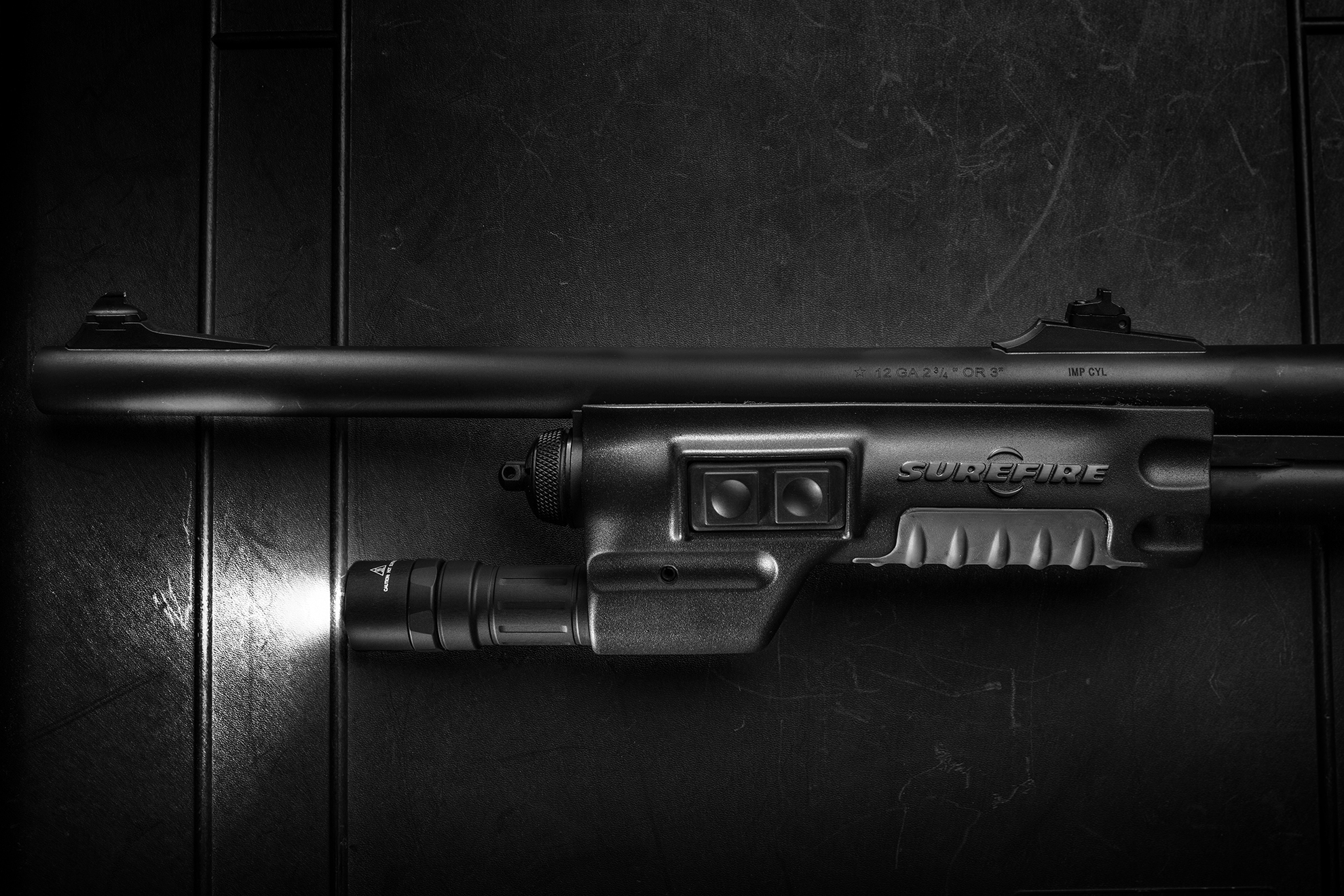 SureFire 618LMG shotgun forend WeaponLight with light turned on
