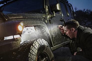 SureFire Titan Plus keychain flashlight with Jeep